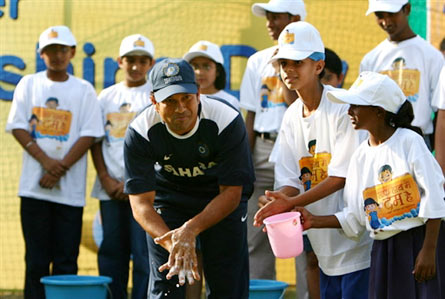 Sachin with school children